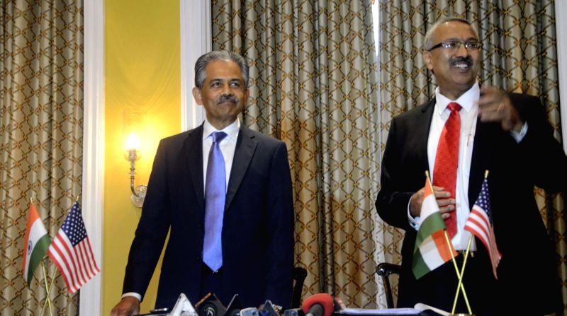 Executive Director of SelectUSA Vinai Tummalapally and Chairman and Managing Director of Export-Import Bank of India Yaduvendra Mathur after signing Memorandum of Intent (MOI) to encourage ...