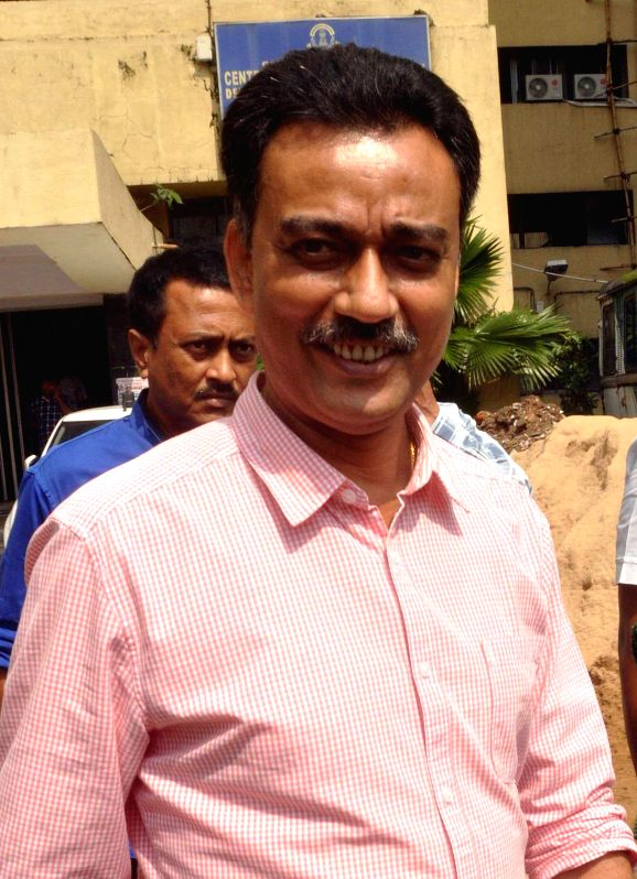 Executive member of East Bengal Club, Debabrata Sarkar arrives to appear before the Enforcement Directorate in connection with the multi-crore-rupee Saradha chit fund scam in Kolkata on Aug 20 2014.