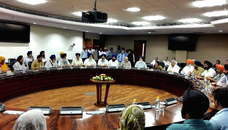 External Affairs Minister Sushma Swaraj and Punjab Chief Minister Parkash Singh Badal during a meeting regarding Indian nationals trapped in violence hit Iraq in New Delhi on June 19, 2014. - Parkash Singh Badal