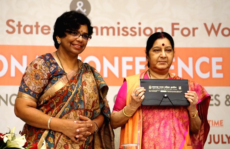 External Affairs Minister Sushma Swaraj and Maharashtra State Commission for Women chairperson Vijaya Rahatkar releases a book on women awareness during the national conference on NRI ... - Sushma Swaraj