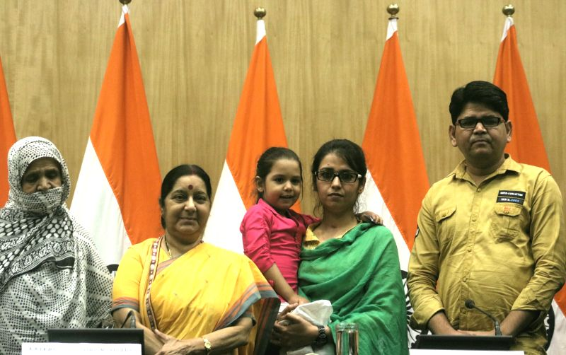 External Affairs Minister Sushma Swaraj as Uzma Ahmed, who alleged she was forced to marry a Pakistani man gets emotional on being re-united with her child in New Delhi, on May 25, 2017. - Sushma Swaraj