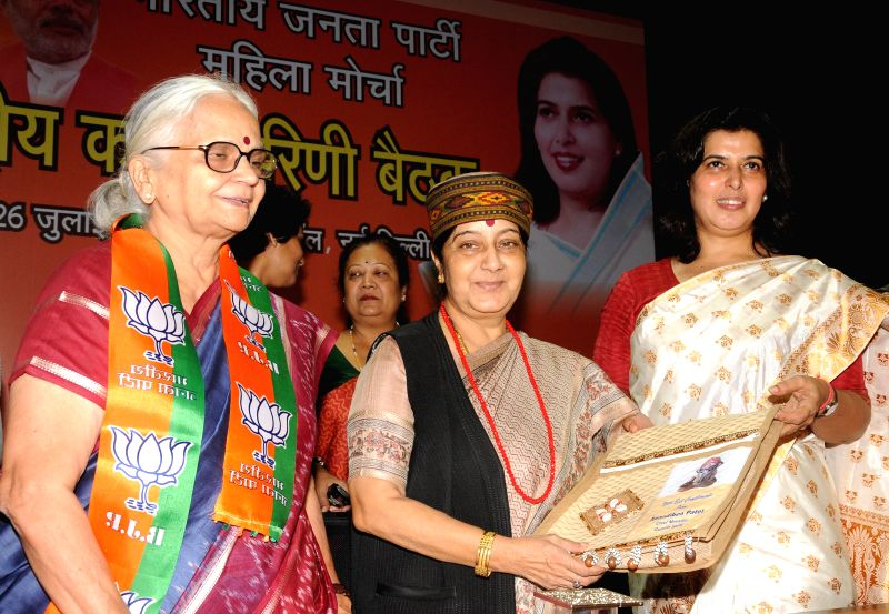External Affairs Minister Sushma Swaraj during inauguration of BJP Mahila Morcha  National Executive meeting in New Delhi on July 25, 2014. - Sushma Swaraj