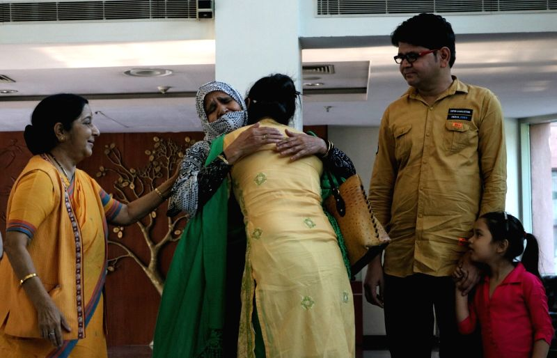 External Affairs Minister Sushma Swaraj looks on as Uzma Ahmed, who alleged she was forced to marry a Pakistani man gets emotional on being re-united with her family in New Delhi, on May ... - Sushma Swaraj