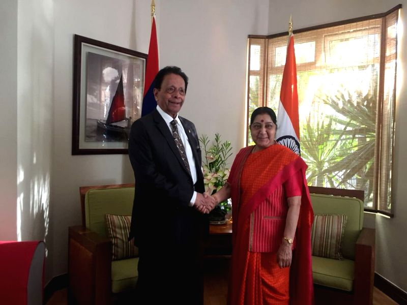 External Affairs Minister Sushma Swaraj meets Mauritius Defence Minister  Sir Anerood Jugnauth during her transit stay in Mauritius, on June 8, 2017. - Sushma Swaraj