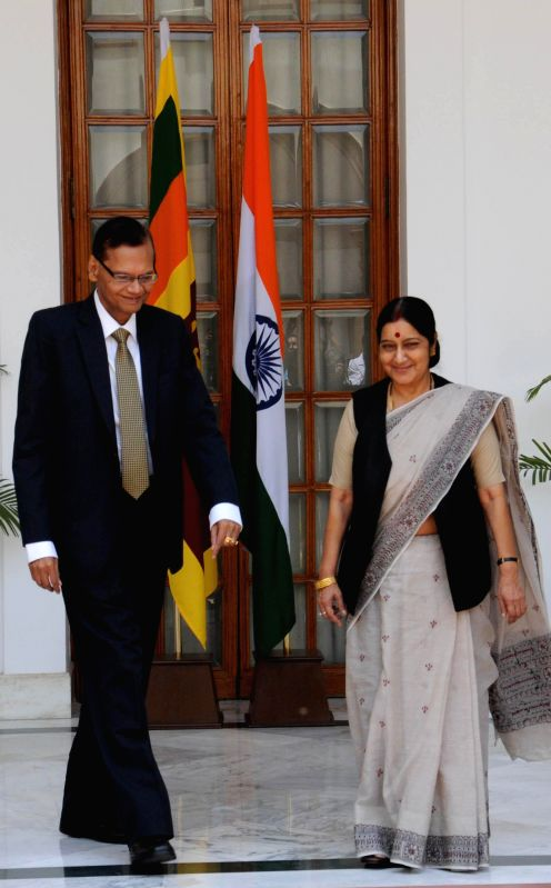 External Affairs Minister Sushma Swaraj shakes hands with her Sri Lankan counterpart GL Peiris during a meeting in New Delhi on July 11, 2014.