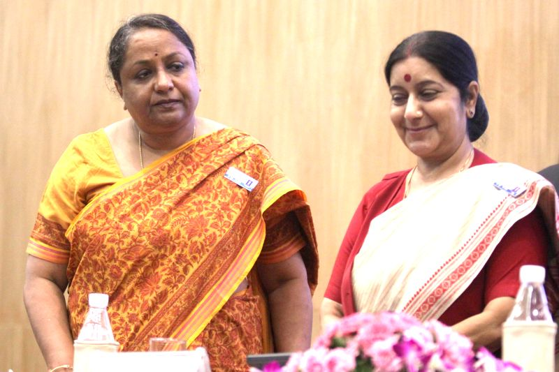 External Affairs Minister Sushma Swaraj with Indian Foreign Secretary Sujata Singh during a programme organised on 'Passport Service Day' in New Delhi on June 24, 2014. - Sushma Swaraj