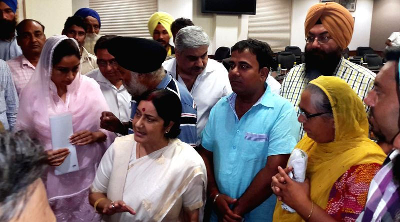 External Affairs Minister Sushma Swaraj with family members of Indians trapped in Iraq, in New Delhi on Aug 19, 2014.