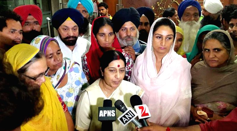 External Affairs Minister Sushma Swaraj with Union Food Processing Industries Minister Harsimrat Kaur Badal addresses press after meeting family members of Indians trapped in Iraq, in New Delhi on ...