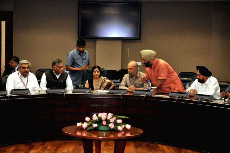External Affairs Minister Sushma Swaraj with MoS External Affairs, General (Retd.) V.K. Singh and others during a meeting regarding Indian nationals trapped in violence-struck Iraq, in New Delhi on .. - Sushma Swaraj and K. Singh
