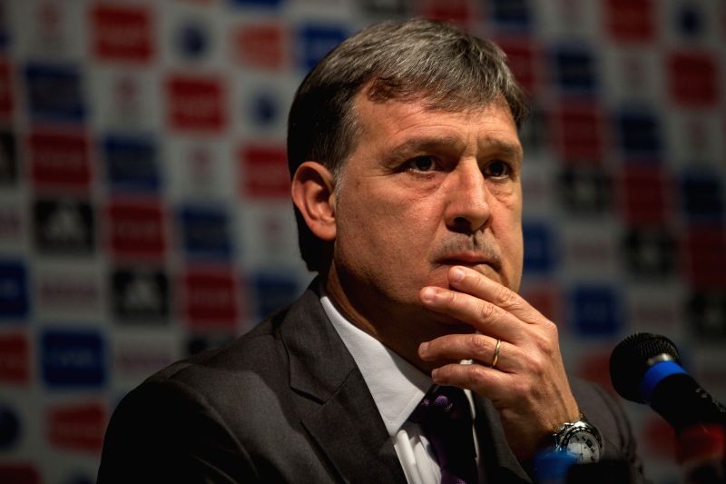 Gerardo Martino reacts during a press conference for his official presentation as the new head coach of the Argentina's national soccer team in the campus of the ...