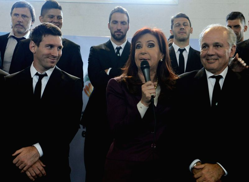 Argentine President Cristina Fernandez (C) delivers a speech in presence of head coach Alejandro Sabella (R), player Lionel Messi (L) and other players of ...