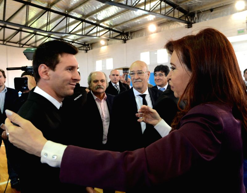 Argentine President Cristina Fernandez (R) greets Lionel Messi (L) of Argentina's national soccer team, at the Argentine Soccer Association (AFA, for its acronym in .