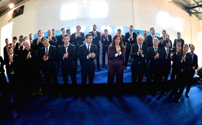 Argentine President Cristina Fernandez (C) poses with  Argentina's national soccer team, at the Argentine Soccer Association (AFA, for its acronym in Spanish), in ...