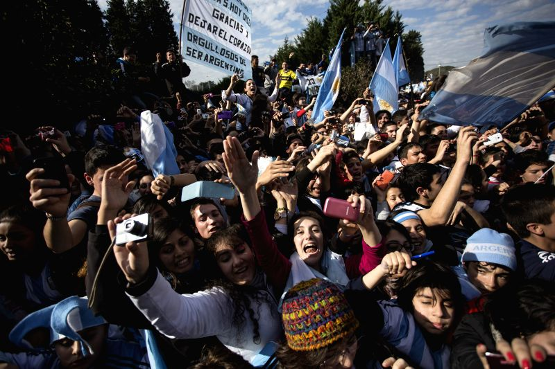 Argentinian fans rally to welcome their national football team upon their arrival, in Ezeiza city, Argentina, on July 14, 2014. Argentina National Team returned ...