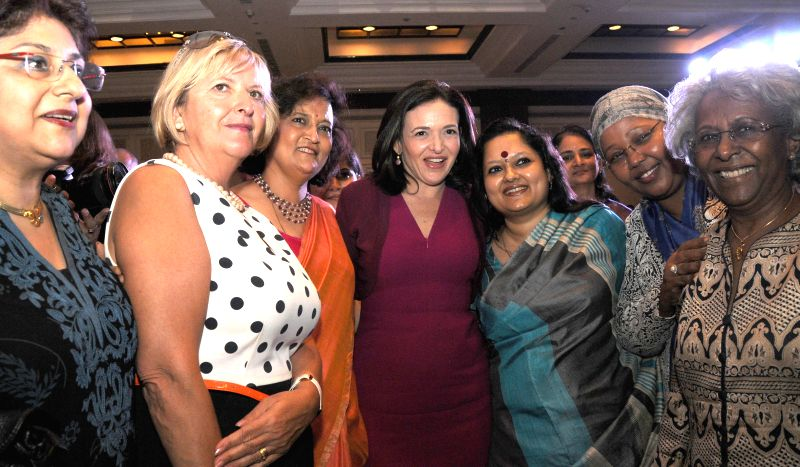 Facebook COO Sheryl Sandberg with FLO President Neeta Boochra and others during a programme in New Delhi on July 2, 2014.