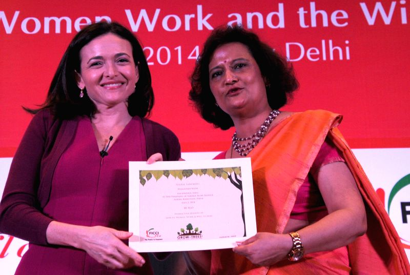 Facebook COO Sheryl Sandberg with FLO President Neeta Boochra during a programme in New Delhi on July 2, 2014.