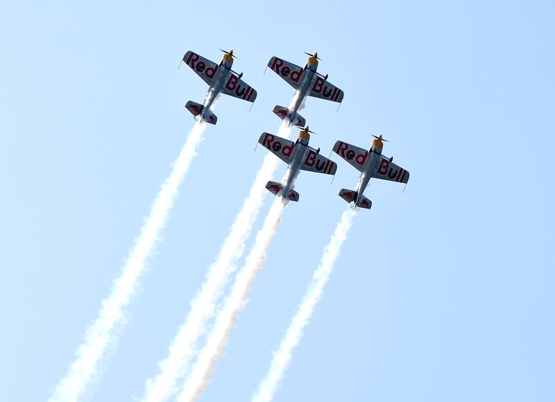 Four planes of the Red Bull Aerobatic Team fly in formation in an air show in Faku, northeast China's Liaoning Province, Aug. 27, 2014. The Red Bull Aerobatic Team of .