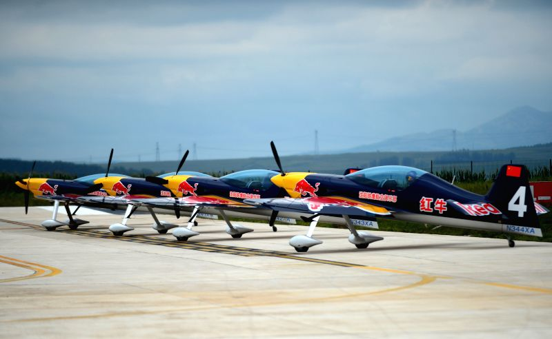 Members of the Red Bull Aerobatic Team of China take part in a training in Faku, northeast China's Liaoning Province, Aug. 25, 2014. The Red Bull Aerobatic Team of ...