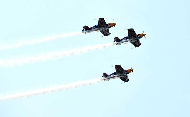 Three planes of the Red Bull Aerobatic Team fly in formation in an air show in Faku, northeast China's Liaoning Province, Aug. 27, 2014. The Red Bull Aerobatic Team of