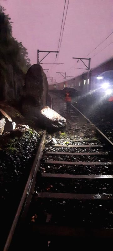 Fallen Boulders and slush breached railway lines on the Mumbai-Nashik & Munbai-Pune sectorsof Central Railway, badly hitting long-distance services to different parts of India, here