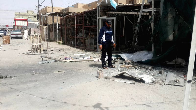 A man stands by a damaged shop after Iraqi Air Force's bombing in Islamic State (IS) militants-seized city of Fallujah, some 50km west of Baghdad, Iraq, April 10, ...