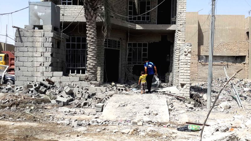 FALLUJAH, April 30. 2015 People inspect a damaged building after Iraqi Air Force's bombing in Islamic State (IS) militants-seized city of Fallujah, some 50 km west of Baghdad, Iraq, April ...