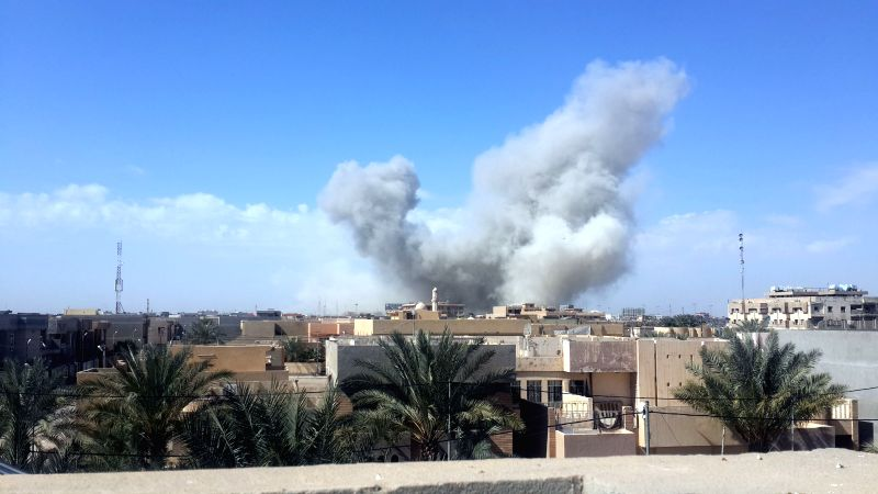 Smoke rises after Iraqi Air Force's bombing in Islamic State (IS) militants-seized city of Fallujah, some 50 km west of Baghdad, Iraq, March 3, 2015. At least ...