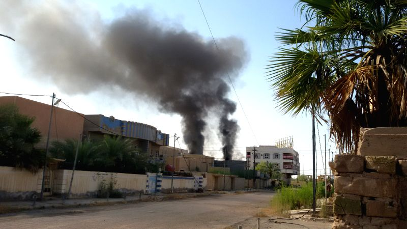 FALLUJAH, May 23, 2016 - Smoke rises after an airstrike by the Iraqi Air Force in Islamic State (IS) militants-seized city of Fallujah, some 50 km west of Baghdad, Iraq, on May 22, 2016. Iraqi Prime ... - Haider