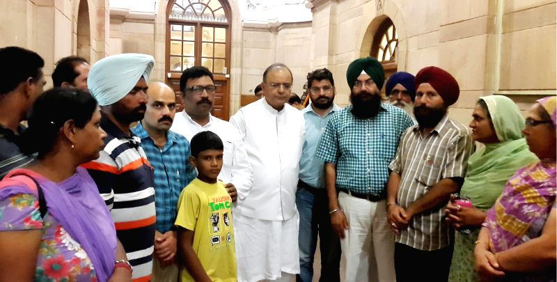Family members of a youth who has been held-up in Mosul, Iraq meet Union Minister for Finance, Corporate Affairs and Defence Arun Jaitley in New Delhi on August 1, 2014.