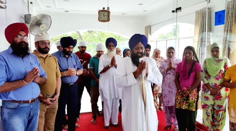 Family members of a youth who has been held-up in Mosul, Iraq pay obeisance at Gurdwara Bangla Sahib in New Delhi on August 1, 2014.