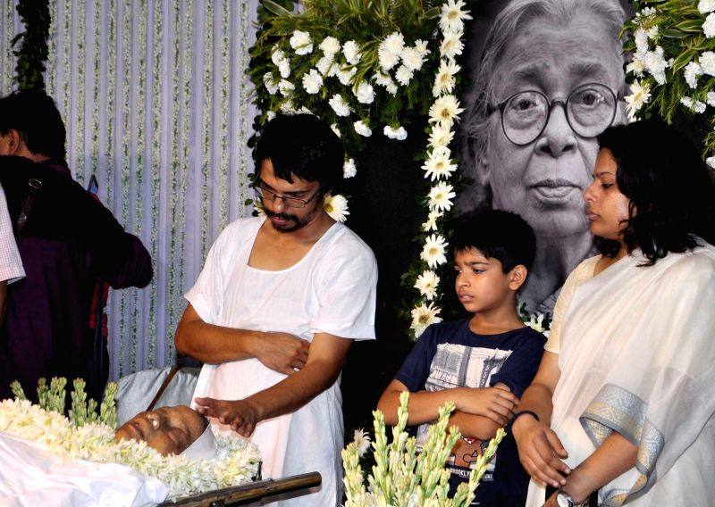 Family members ​of eminent writer and social activist Mahasweta Devi pay tribute to her at Rabindra Sadan in Kolkata on July 29, 2016. She passed away on 28th July following a cardiac ...