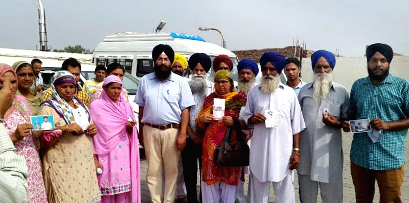 Family members of Indians who are believed to be trapped in violence-hit Iraq ahead of leaving for Delhi to meet Sushma Swaraj, in Amritsar on June 19, 2014. - Sushma Swaraj