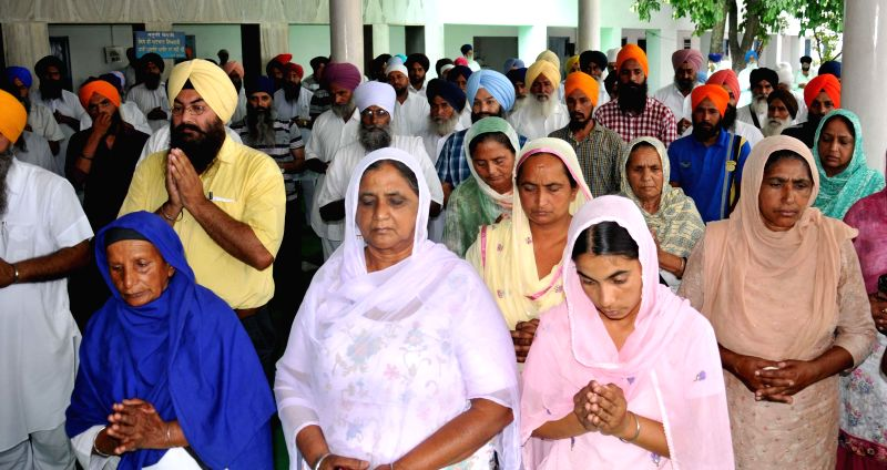 Family members of Indians who are trapped in violence-hit Iraq pray for their safety at Baba Budha Ji Sahib Gurdwara in Kathunangal of Amritsar on June 24, 2014.