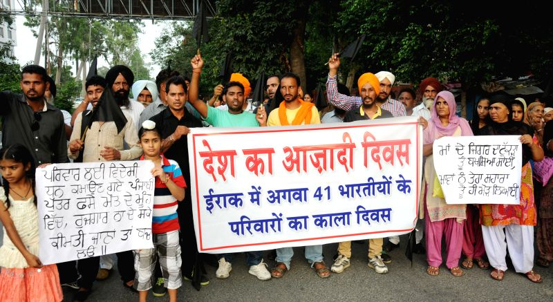 Family members of Indians who are trapped in violence-hit Iraq stage a demonstration to protest against government's failure to bring them home in Amritsar on Aug 15, 2014. They also observed ...