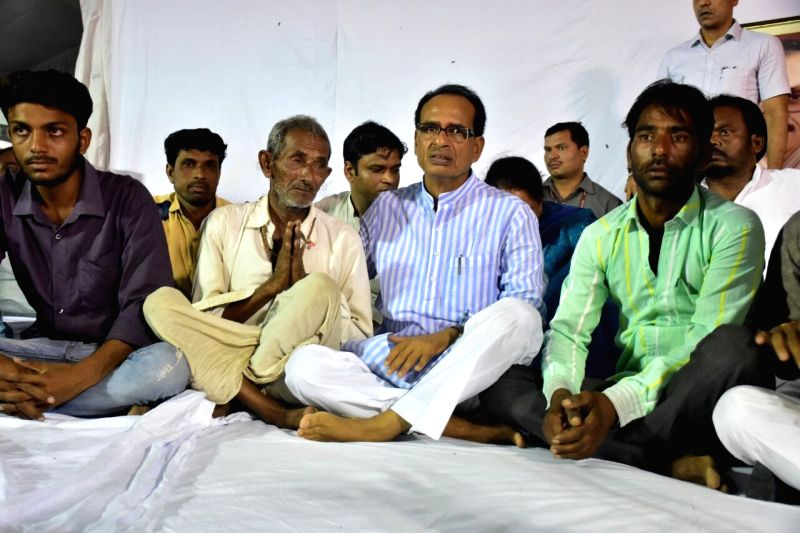 "Family members of Madhya Pradesh farmers who were killed  in an alleged police firing join Chief Minister Shivraj Singh Chouhan who went on an indefinite fast  ""until peace is ... - Shivraj Singh Chouhan"