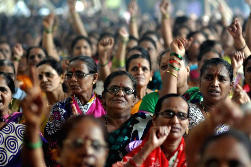 Family members of Mumbai Police personnels stage a demonstration in Mumbai on Aug 7, 2014.