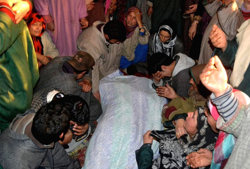 Family members with the body of Ghulam Muhammad Mir, headman of Hygam village in Baramulla on Dec. 13, 2014. The village headman was kidnapped by gunmen from his house in Jammu and Kashmir's ...
