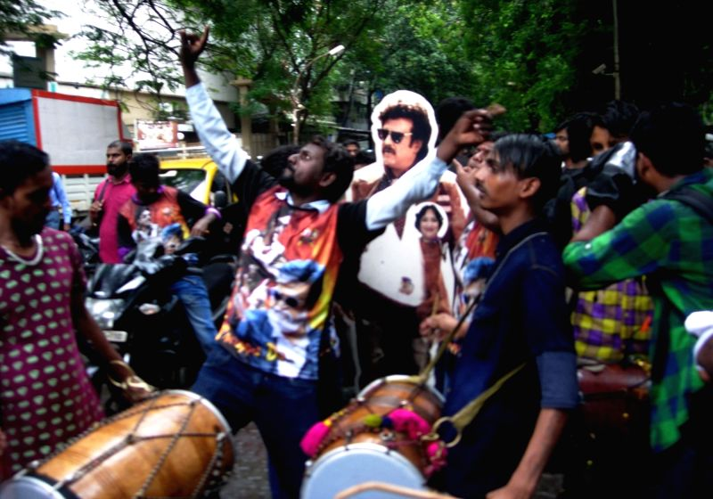 Fans celebrates the release of actor Rajinikanth's film Kabali in Mumbai on July 22, 2016. - Rajinikant