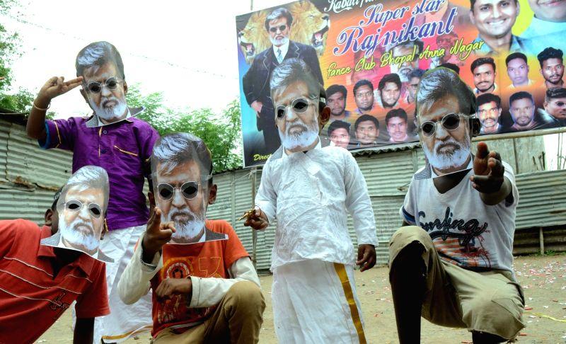 Fans celebrates the release of actor Rajinikanth's film Kabali in Bhopal on July 22, 2016. - Rajinikant