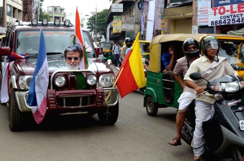 Fans celebrates the release of actor Rajinikanth's film Kabali in Bengaluru on July 22, 2016. - Rajinikant