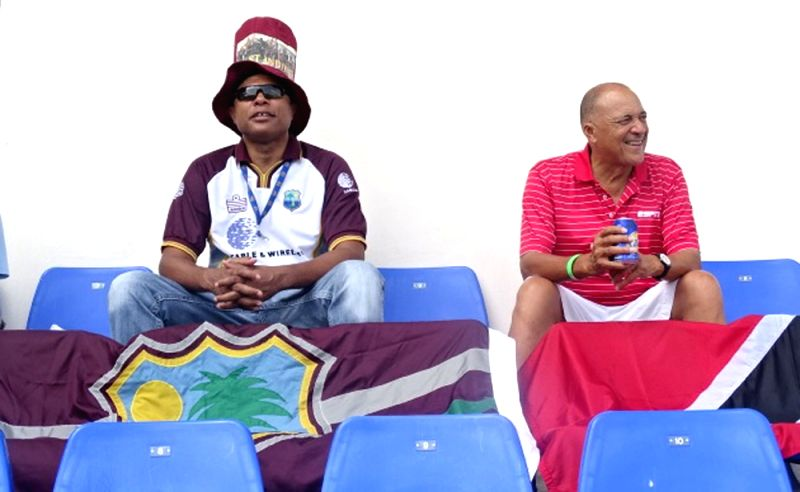Fans cheer during the first test match between India and West Indies at Sir Vivian Richards Stadium in Antigua on July 21, 2016.