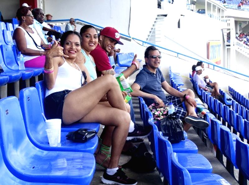 Fans cheers during the first test match between India and West Indies at Sir Vivian Richards Stadium in Antigua on July 22, 2016.