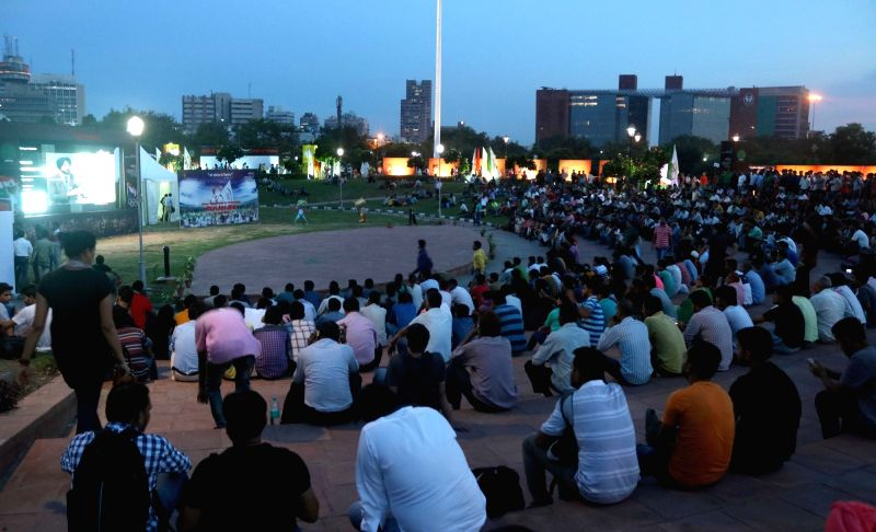 Fans enjoys the hockey match between India and Ireland during the 2016 Rio Olympic Games; on the giant screen at Central Park, Connaught Place of New Delhi on Aug. 6, 2016.