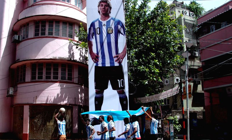 Fans of Argentine football team cheer for the team ahead of FIFA World Cup Finals in Kolkata on July 11, 2014.