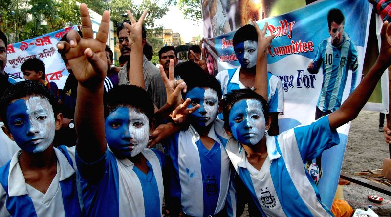 Fans of Argentine football team cheer for the team ahead of FIFA World Cup Finals in Kolkata on July 12, 2014.