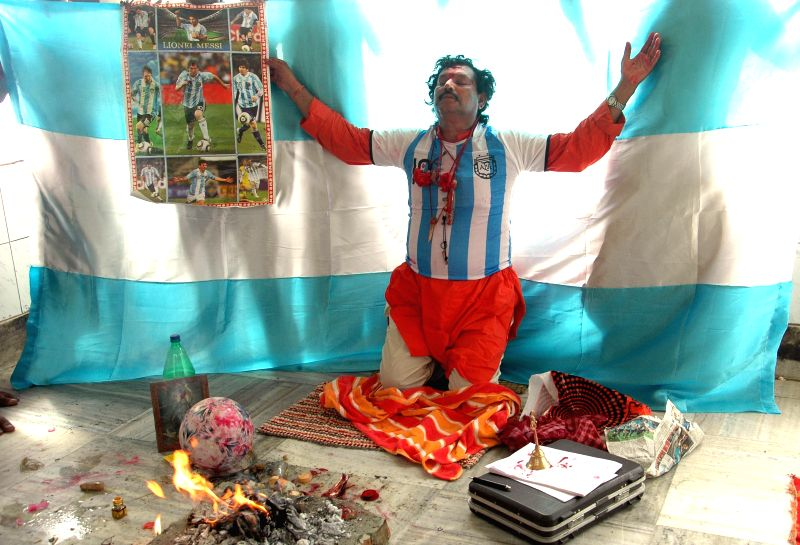 Fans of Argentine football team perform rituals to pray for team's victory in the finals of FIFA World Cup 2014 in Kolkata on July 11, 2014.