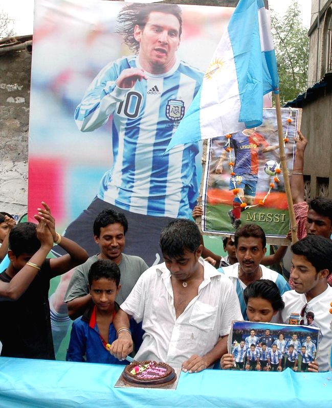 Fans of Argentine footballer Lionel Messi celebrate his birthday in Kolkata on June 24, 2014.