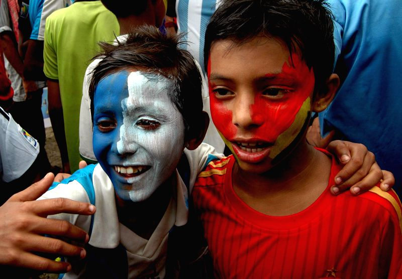 Fans of German and Argentine football team cheer for their respective  teams ahead of FIFA World Cup Finals in Kolkata on July 12, 2014.
