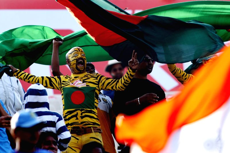 Fans with the Bangladesh flag cheer their team during the test match between India and Bangladesh in Hyderabad on Feb. 11, 2017.