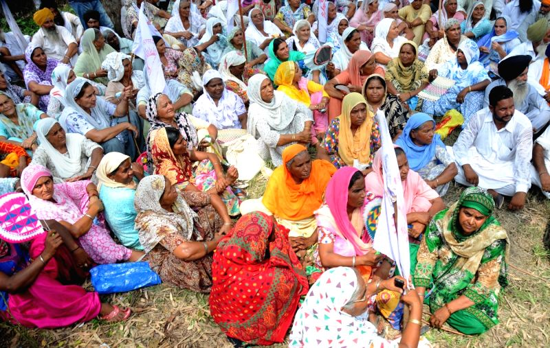 Farmers protest against the central and state government for their demand for new tubewell connections, outside the Punjab State Power Corporation Ltd Chief Engineer office in Amritsar on ...